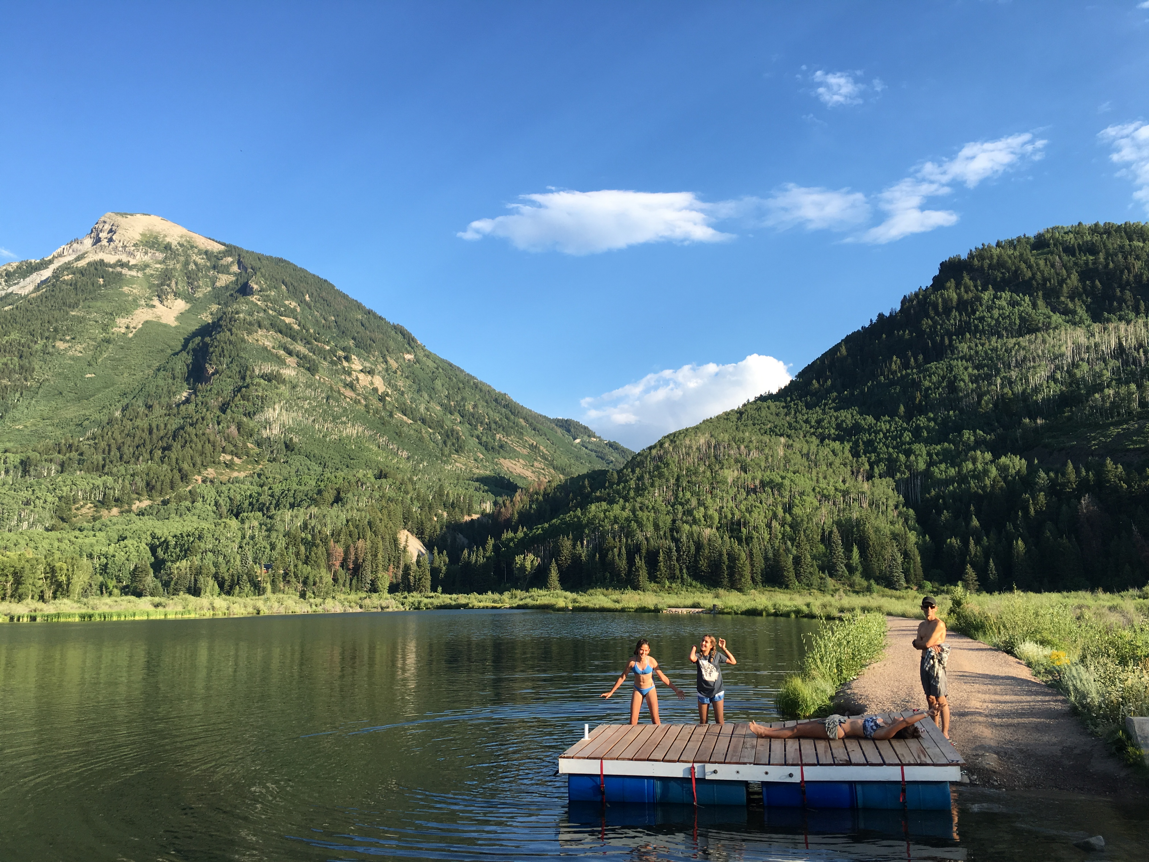 Swimming and Paddleboarding in Beaver Lake, Marble, Colorado